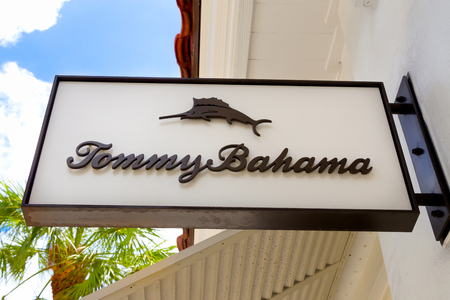 bahama: FORT LAUDERDALE, FLAUSA - APRIL 10, 2017: Tommy Bahama exterior store sign and logo. Tommy Bahama is a Seattle-based manufacturer of casual, mens and womens clothing.