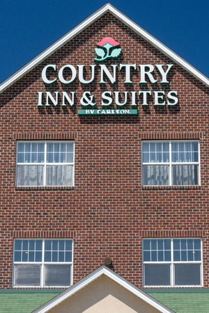 ST. PAUL, MNUSA - MAY 7, 2017: Country Inn and Suite exterior sign and log0. Country Inns and Suites by Carlson is the upper mid-scale hotel brand within the Carlson Rezidor Hotel Group portfolio. Editorial