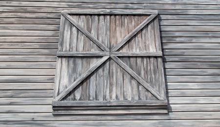 풍 화 헛간 clapboard 사이 딩 및 닫힌 된 로딩 문입니다. 스톡 콘텐츠