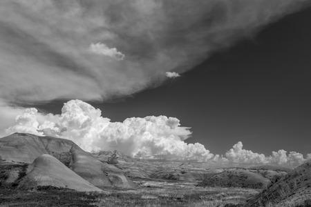 Billowing puffy white clouds at Badlands National Park, South Dakota, USA.