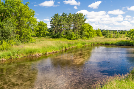Shallow flowing Kinnickinnic River in rural western Wisconsin, USA. Stock Photo