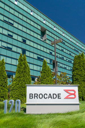 specializes: SAN JOSE, CAUSA - JULY 29, 2017: Brocade Corporate Headquarters and logo. Brocade Communications Systems, Inc. specializes in data and storage networking products. Editorial