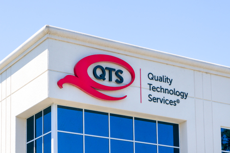 SANTA CLARA, CAUSA - JULY 29, 2017: Quality Technology Services exterior and logo. QTS is a real estate investment trust that owns, operates or manages 25 multi-tenant data centers internationally.