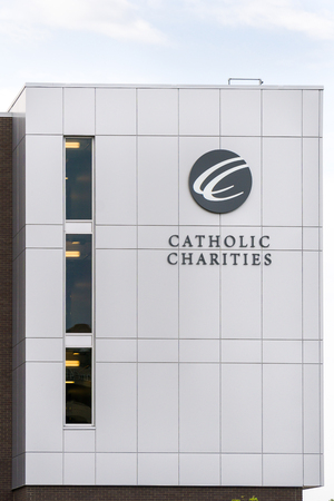 ST PAUL, MNUSA - SEPTEMBER 10, 2017: Catholic Charities mission exterior and logo. Catholic Charities provides economic relief to the poor.