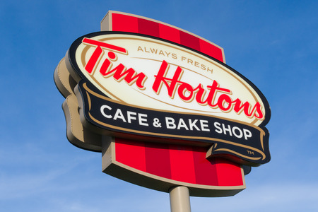 COLUMUBUS, OHUSA - OCTOBER 21, 2017: Tim Hortons restaurant exterior and logo. Tim Hortons Inc. is a Canadian multinational fast food restaurant chain. Editorial