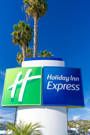 LA JOLLA, CAUSA - JANUARY 13, 2018: Holiday Inn Express Sign motel exterior. Holiday Inn Express is a mid-priced hotel chain branded by InterContinental Hotels Group. Editorial