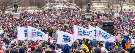 ST. PAUL, MNUSA - MARCH 24, 2018: Panorama of Unidentified individuals participating in the March for our Lives protest at the Minnesota State Capitol.