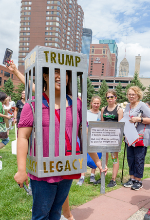 MINNEAPOLIS, MNUSA - JUNE 30, 2018: Unidentified individuals participating in the Families Belong Together march in protest of U.S. Immigration policy separating migrant children from parents.