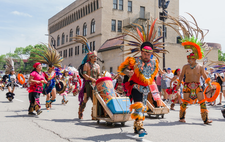 MINNEAPOLIS, MNUSA - JUNE 30, 2018: Unidentified individuals in Mexican indigenous costomes at the Families Belong Together march in protest of U.S. Immigration policy separating migrant children from parents. Sajtókép