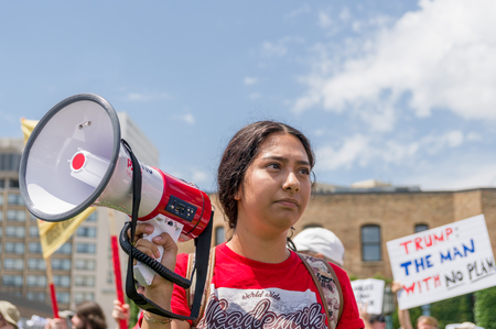 MINNEAPOLIS, MNUSA - JUNE 30, 2018: Unidentified individual holding a megaphone at  the Families Belong Together march in protest of U.S. Immigration policy separating migrant children from parents.