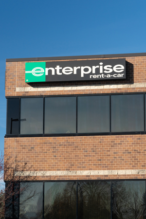 ST. PAUL, MN/USA - NOVEMBER 18, 2018: Enterprise car rental front and sign. Enterprise Rent-A-Car is a car rental company headquartered in the United States.