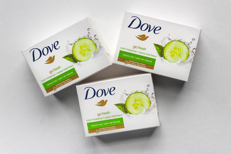 ST. PAUL, MN/USA - FEBRUARY 24, 2019: Dove bar soap in grouping of three. Dove is a personal care brand owned by Unilever.