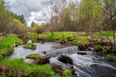 Secluded stream and waterfall near Glen Hills Park in St. Croix County, Wisconsin, USA.