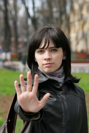 The serious girl stops you a palm out of focus Stock Photo