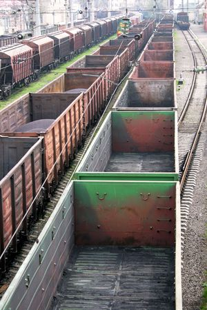 Many empty freight cars on rails move to a distance
