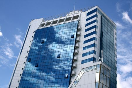 Blue with white a skyscraper with reflection of clouds Stock Photo - 3276288