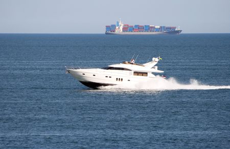 The white motor yacht rushes on the sea