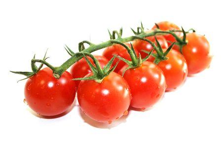 Green branch fresh ripe red tomato Stock Photo