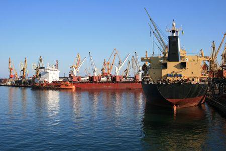 Dry-cargo ships under unloading at port moorings
