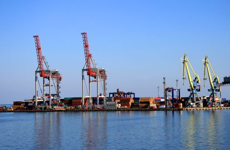 Mooring of trading port with cranes and cargo transporters
