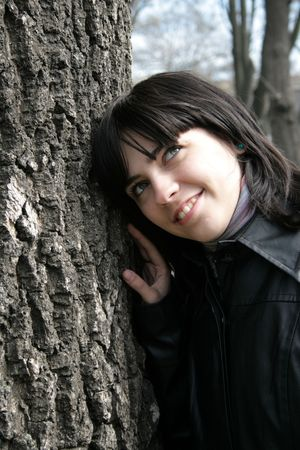 young girl at an old tree