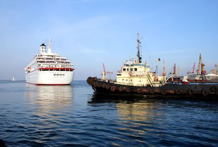 tow sees off the passenger ship from port harbour