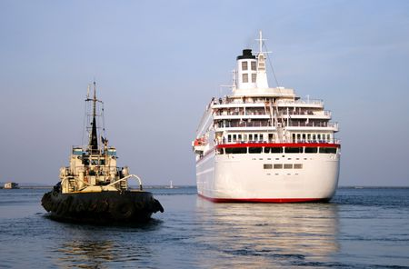 tugboat sees off the passenger ship Stock Photo - 4581034
