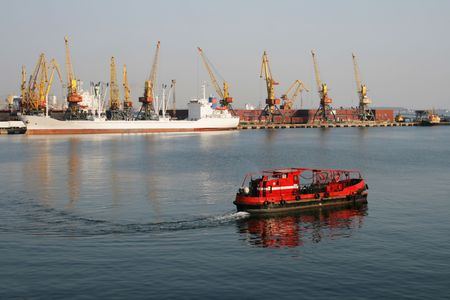 Cleaner of water area of port