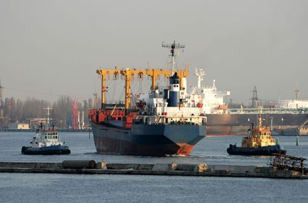 Two tows get the dry-cargo ship in port
