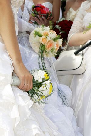Group of brides with bouquets in hands