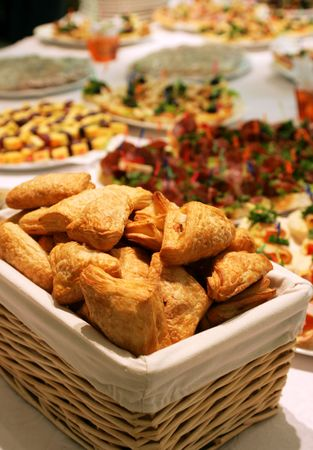 Puff pies in a basket on a buffet table Stock Photo