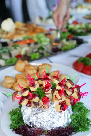 Cheese and grapes slices beautifully served with salad leaves