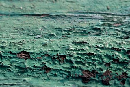 peeled off paint on a wooden surface a background in grunge style  Stock Photo
