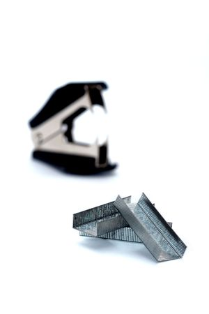 clips and stapler on a white background