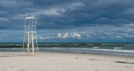 Sea coast in the autumn with an abandoned lifeguard tower