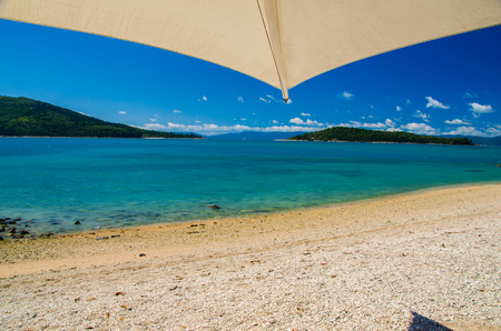daydream: Beach with parasol on the beautiful Daydream Island. Stock Photo
