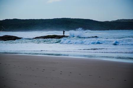 lonesomeness: Surf fisherman  One Mile Beach, Port Stephens,  Australia.