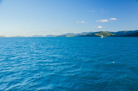 lonesomeness: A sailboat near Dunk Island in the Whitsundays.
