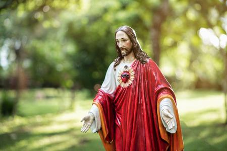 Jesus Christ Statue on green background 版權商用圖片