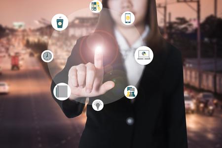 Business woman hand pushing button Standard-Bild