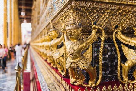 Golden Garuda statues surrounding Wat Phra Kaew temple