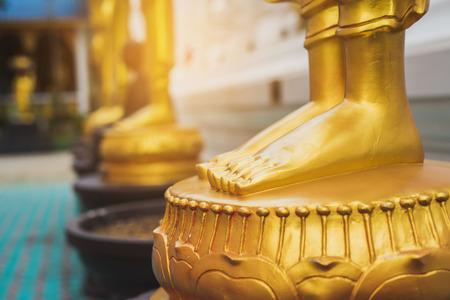 feet of Golden Buddha statue Stock Photo