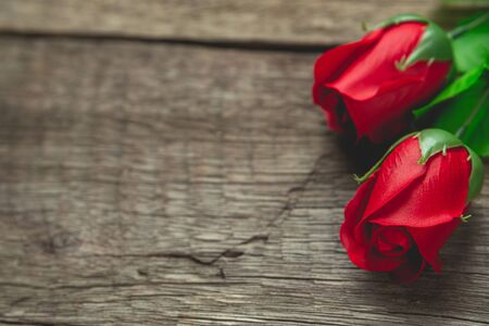 red rose flowers on wood table
