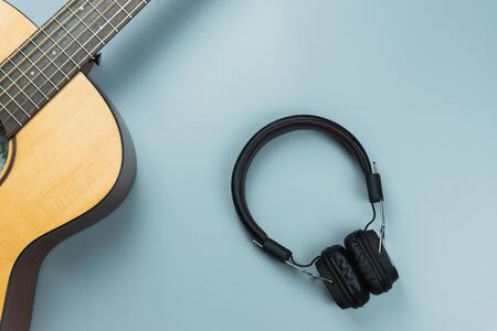 top view guitar and note book and headphone, music concept Imagens