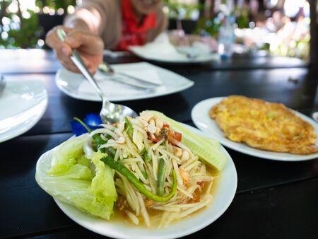 Som Tum Thai Isan Food, Thai papaya salad on the table Banco de Imagens