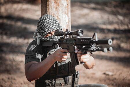 Man terrorist wearing a mask and holding a gun, Terrorist concpet Stock Photo
