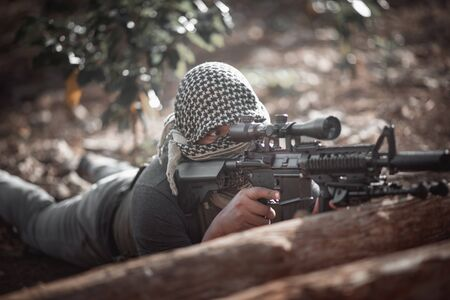 Man terrorist wearing a mask and holding a gun, Terrorist concpet Stok Fotoğraf