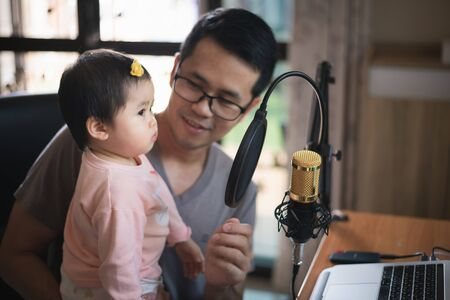 musician man and his daughter recording music at the music home studio Stock Photo