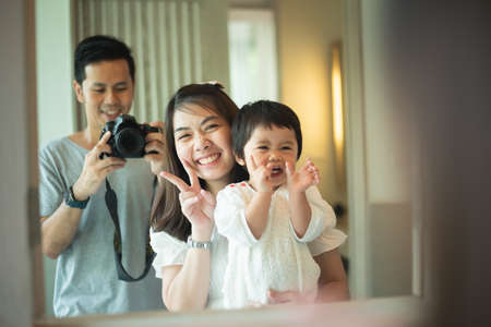 cute family taking a photo in the bedroom, family concept