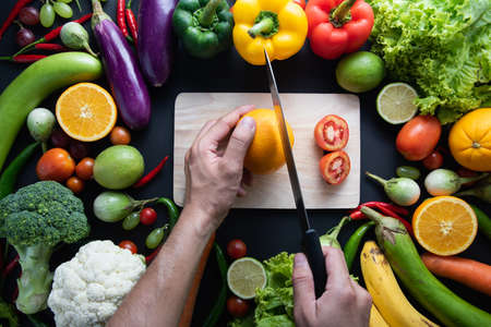Healthy food concept of fresh organic vegetables and wooden desk background. Ingredients top view